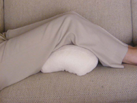 Use the HappiNeck Neck Pillow under your legs